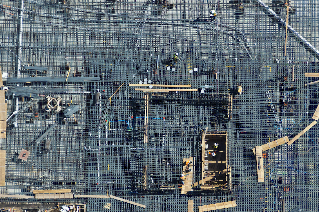 The rebar is laid prior to laying a concrete slab for an apartment in San Francisco, California.