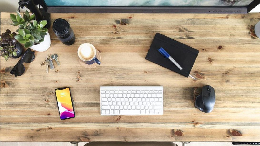 Turn your desktop into an invisible wireless charging pad and get a $35 power bank for free