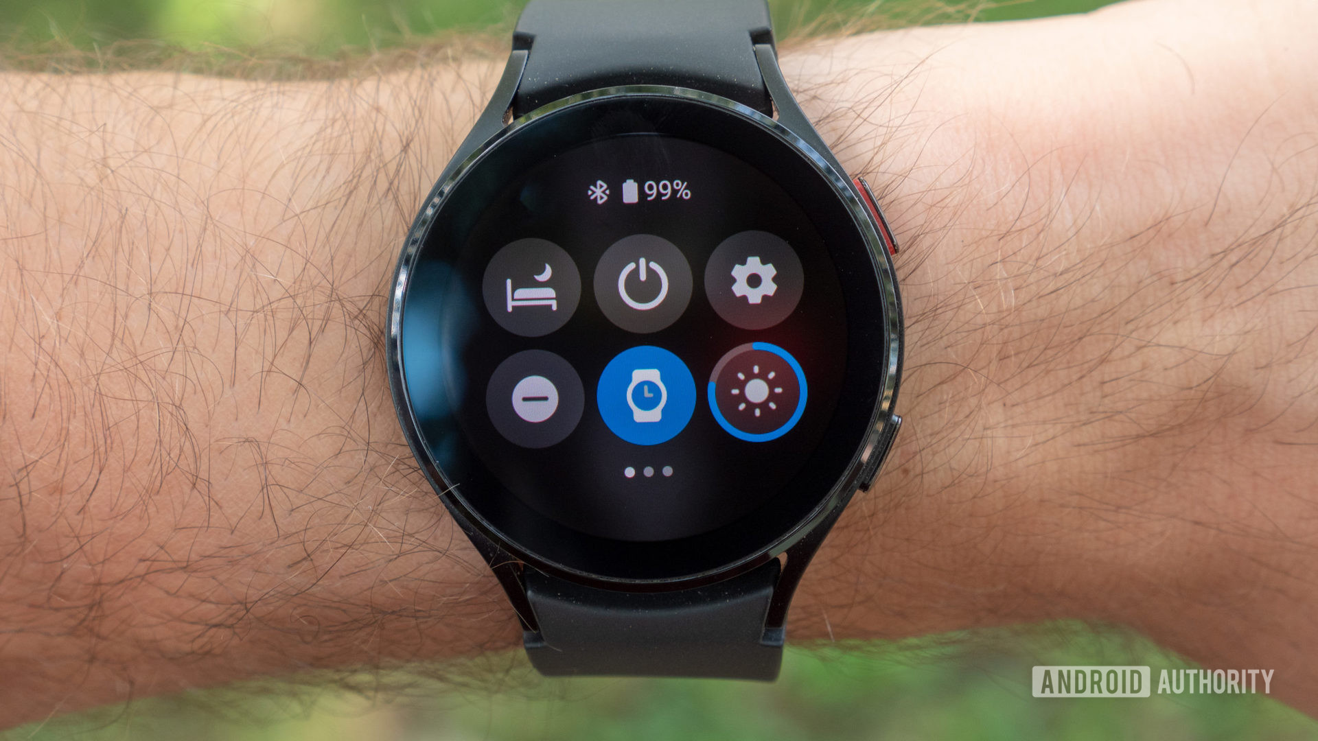 The Samsung Galaxy Watch 4 showing Wear OS 3's quick settings.